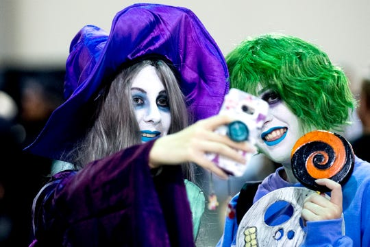 Visitors take a photo together during the annual Knoxville CreepyCon at the World's Fair Exhibition Hall in Knoxville, Tennessee on Saturday, August 25, 2018. The event featured performers, a zombie beauty contest, workshops and a wide selection of vendors.