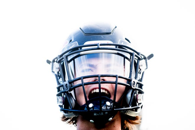 A player gets pumped up before a football game.