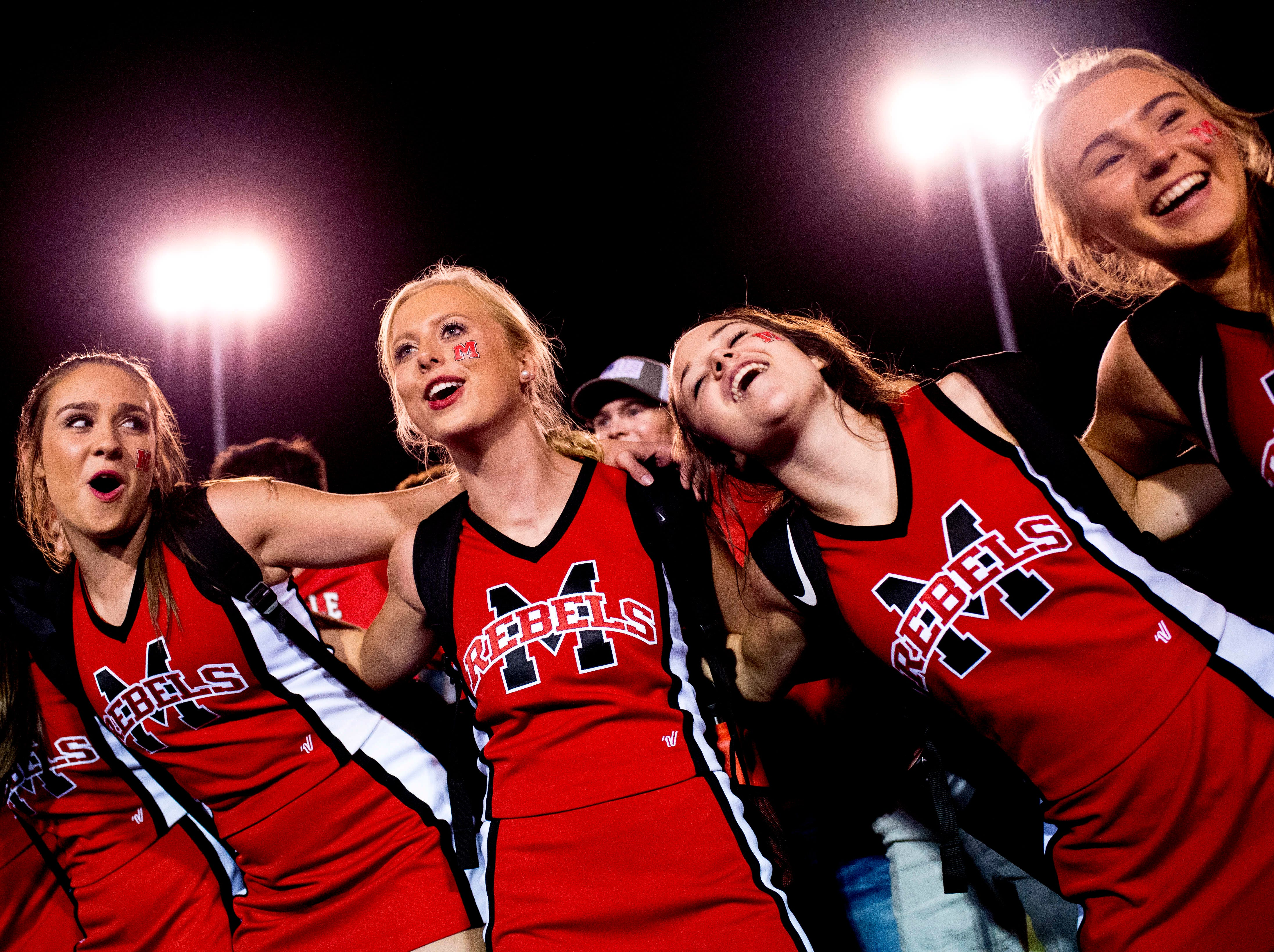 Maryville cheerleaders sing after defeating Oakland a football game between Maryville and Oakland at Maryville High School in Maryville, Tennessee on Friday, August 24, 2018.