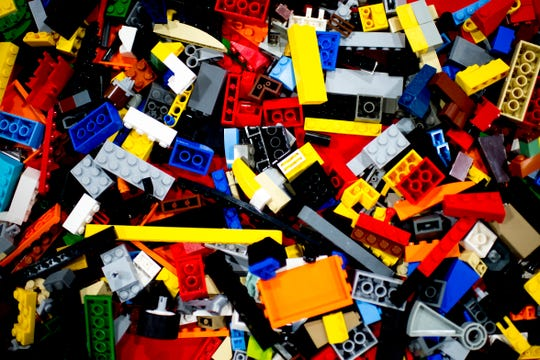 lego pieces lie on a table at the BrickUniverse Knoxville LEGO Fan Expo in the Knoxville Convention Center in Knoxville, Tennessee on Saturday, August 25, 2018. Life-sized LEGO displays, over 40 world landmarks build to-scale from LEGO as well as castles, trains, and cities and other creations were on display.