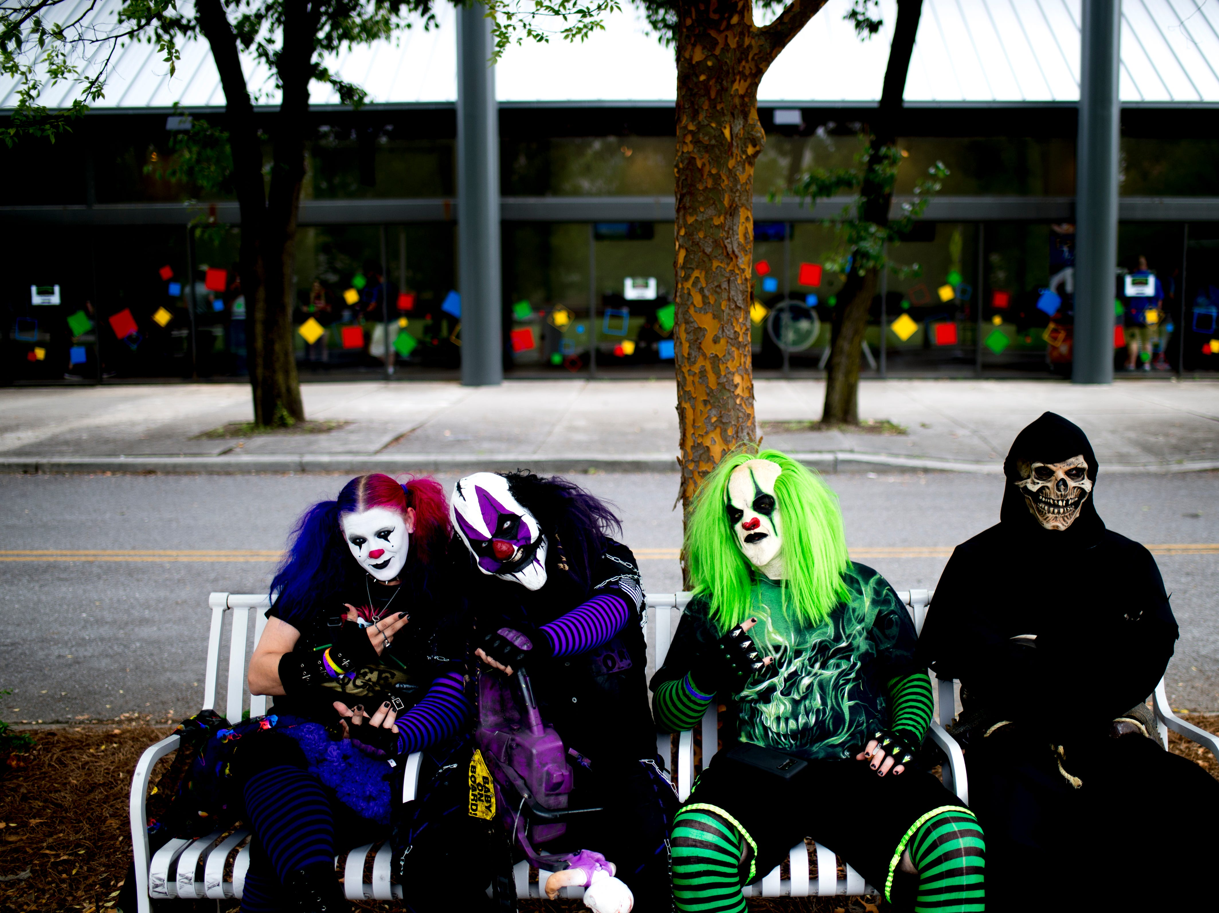 "Members of the group ""Realm of Oddities"" take a break on a bench outside of the annual Knoxville CreepyCon at the World's Fair Exhibition Hall in Knoxville, Tennessee on Saturday, August 25, 2018. The event featured performers, a zombie beauty contest, workshops and a wide selection of vendors."