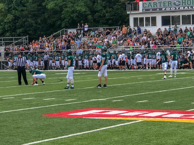 Wesley Rice, 76, gets ready for the opening kickoff