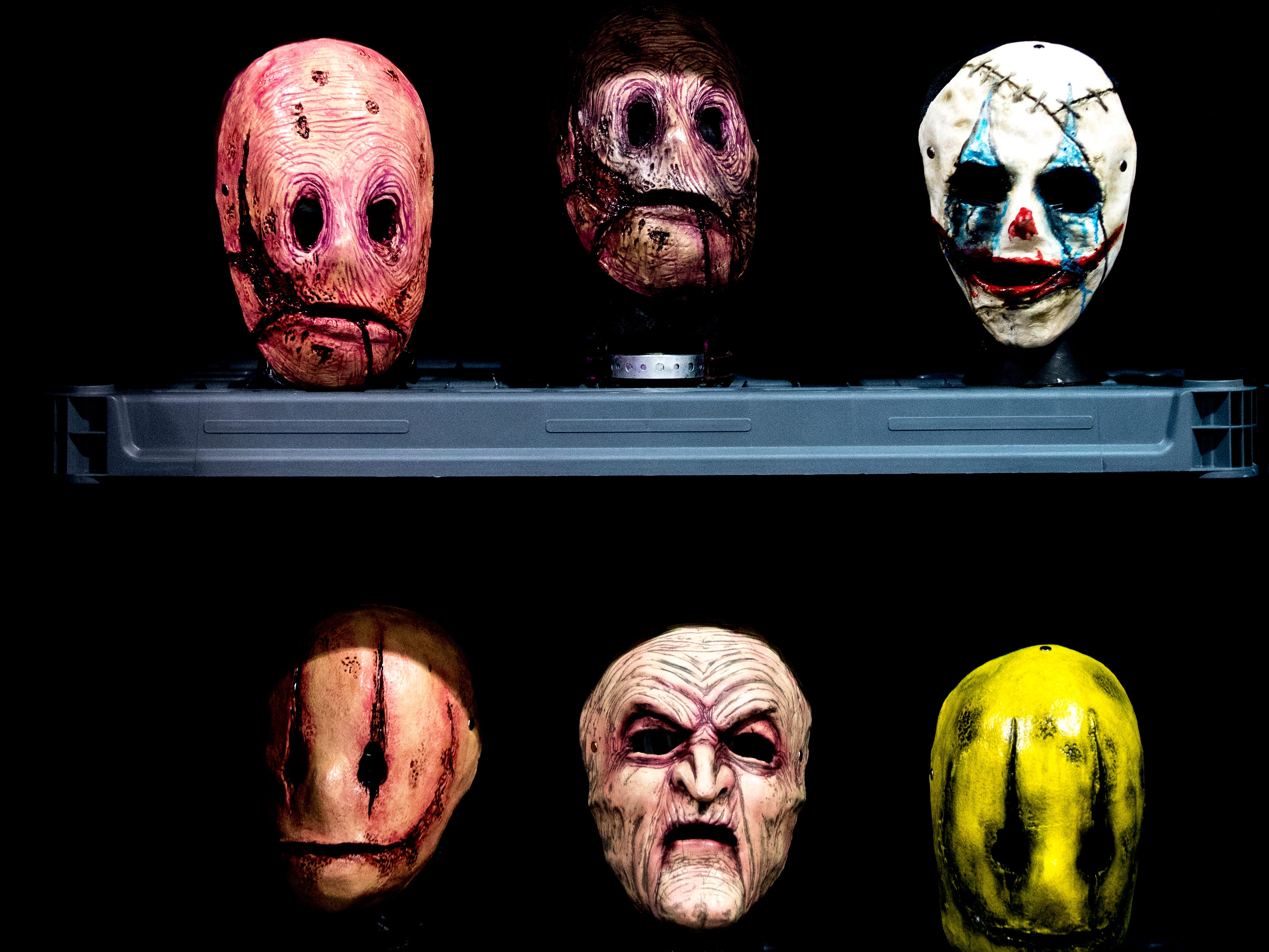 Masks for sale in the Monster Mafia booth during the annual Knoxville CreepyCon at the World's Fair Exhibition Hall in Knoxville, Tennessee on Saturday, August 25, 2018. The event featured performers, a zombie beauty contest, workshops and a wide selection of vendors.
