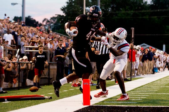 Maryville's Tee Hodge (44) jumps into the end zone during a football game between Maryville and Oakland at Maryville High School in Maryville, Tennessee on Friday, August 24, 2018.