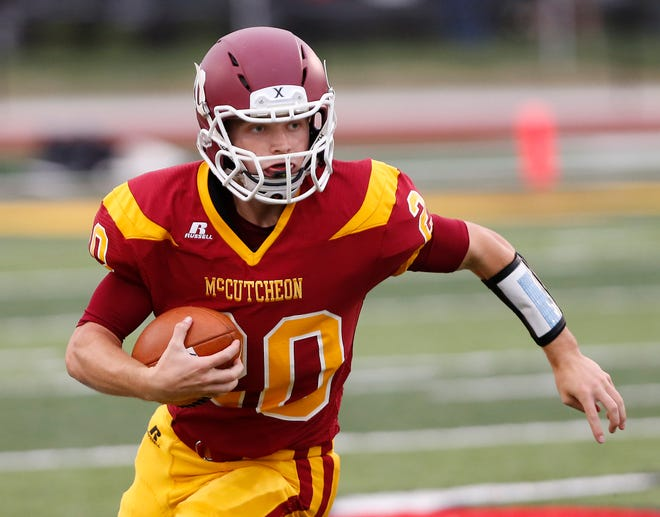 Garrett Maish of McCutcheon with a carry against West Lafayette Friday, August 24, 2018, in Lafayette. West Lafayette defeated McCutcheon 34-20.