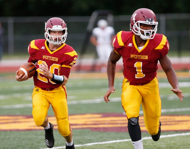 Garrett Maish of McCutcheon looks for running room behind the block of teammate Stephen McWilliams against West Lafayette Friday, August 24, 2018, in Lafayette. West Lafayette defeated McCutcheon 34-20.