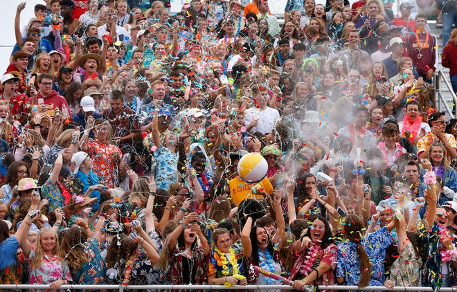 The McCutcheon student section fires Silly String into the air as West Lafayette kicks off to the Mavericks Friday, August 24, 2018, in Lafayette. West Lafayette defeated McCutcheon 34-20.
