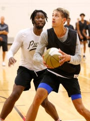 Zach Loveday of Galla Academy High School works for a shot while guarded by former Boilermaker great Caleb Swanigan at the Purdue Elite Basketball Camp Saturday, August 25, 2018, at the France A. Cordova Recreational Sports Center.