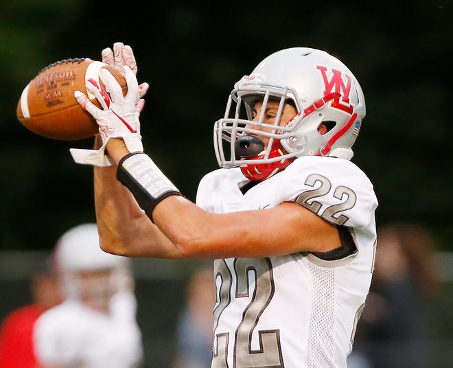 R.J Erb makes a touchdown catch to give West Lafayette the lead in an eventual 34-20 victory against McCutcheon.