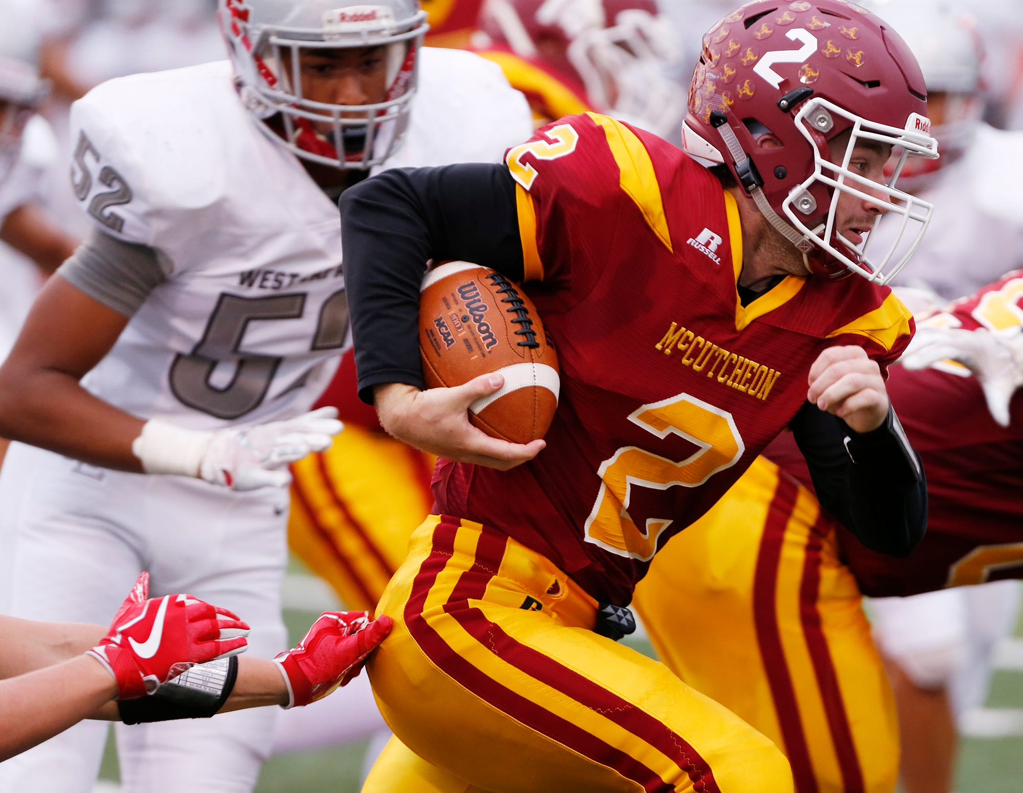 McCutcheon quarterback Peyton Williams with a carry against West Lafayette Friday, August 24, 2018, in Lafayette.