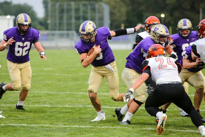 Fowlerville quarterback Geoff Knaggs runs for one of his three touchdowns in a 34-17 victory over Charlotte on Friday, Aug. 24, 2018.