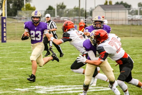 Fowlerville's Tom Salois carries the football in a 34-17 victory over Charlotte on Friday, Aug. 24, 2018.