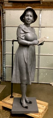 Lexington artist Amanda Matthews creates a clay model of the statue of Alice Allison Dunnigan, a pioneering black female journalist.