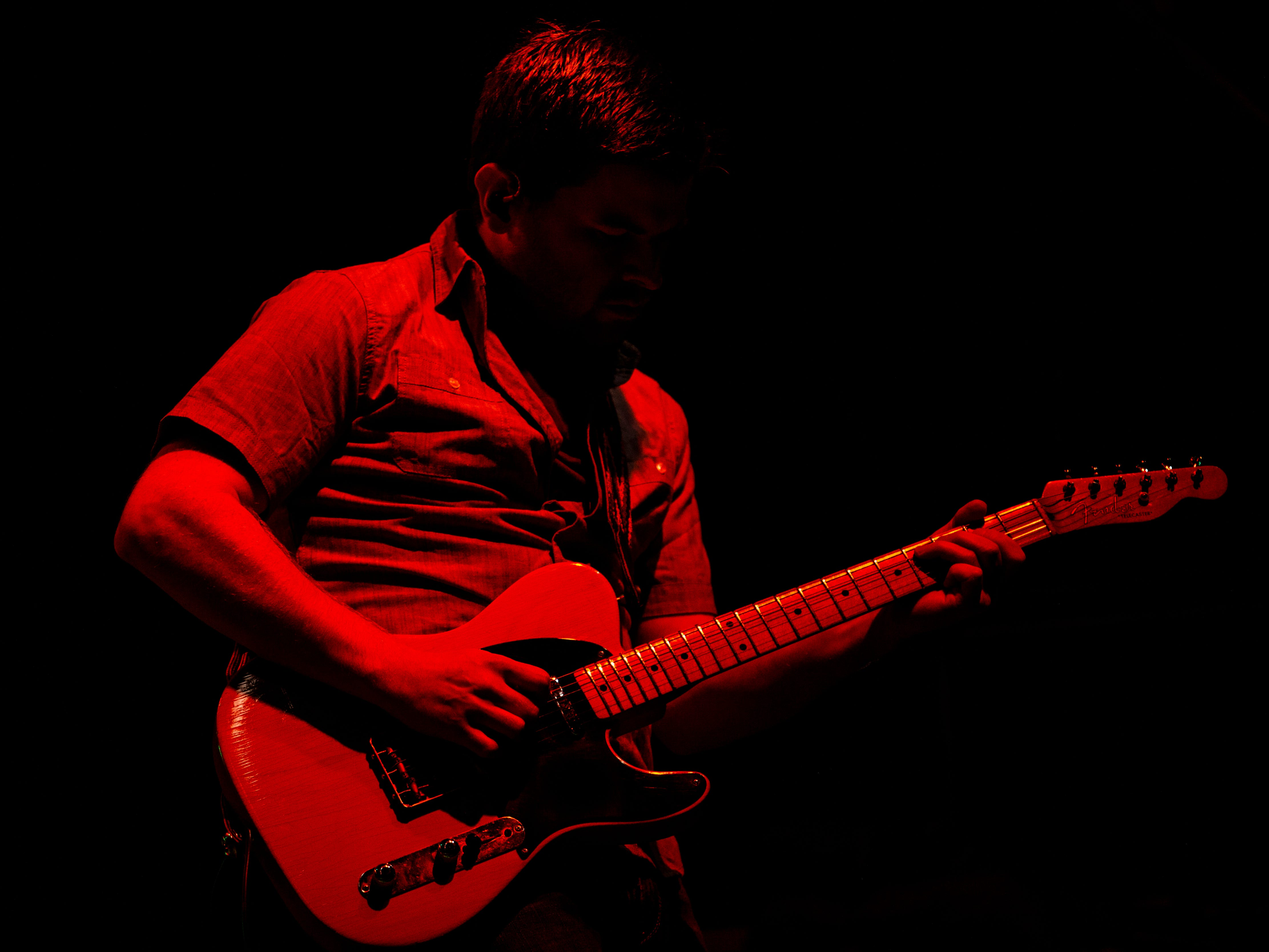 The guitarist for Josh Turner's band was bathed in red light as he performed at the Kentucky State Fair. August 24, 2018