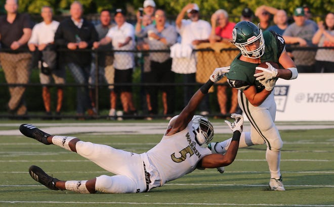Trinity's Kyle Feger (47) intercepted a pass intended for Warren Central's Montrez Stanley (5) during their game at Trinity High School.Aug. 24, 2018