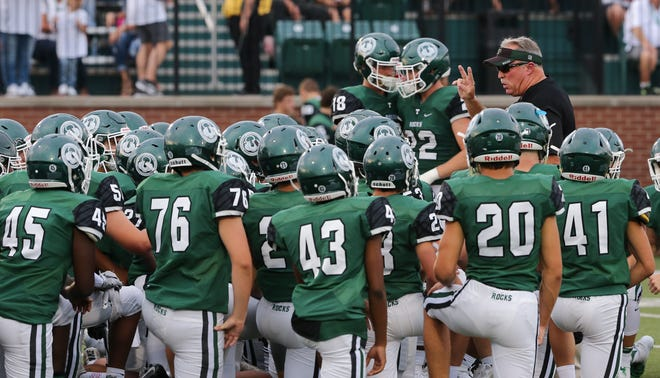 Trinity Head Coach Bob Beatty talked to his team at the start of the second half against Warren Central at Trinity High School.  Trinity starts the season at 0-2 for the first time since 2014.Aug. 24, 2018