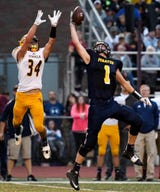 Lansing State Journal reporters Brian Calloway and Nathaniel Bott make their predictions for the Week 2 games in the 2018 high school football season.