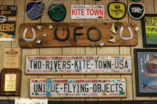 Signs customers made for Chow Chong hang above the register at Unique Flying Objects Tuesday, August 7, 2018, in Two Rivers, Wis. Josh Clark/USA TODAY NETWORK-Wisconsin