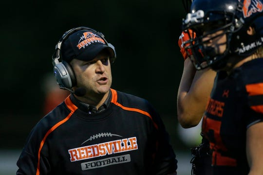 Reedsville's coach Aaron Fredrick talks to his guys on the sidelines between plays during a Big East Conference matchup against Ozaukee at Reedsville High School Friday, August 24, 2018, in Reedsville, Wis. Josh Clark/USA TODAY NETWORK-Wisconsin