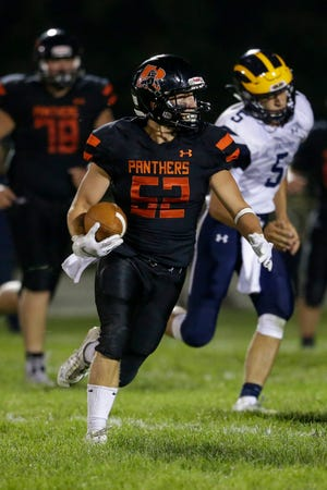 Reedsville's Connor Schwahn (52) runs for a touchdown after an interception against Ozaukee in the second half of a Big East Conference matchup Friday at Reedsville High School.