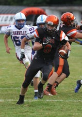 Lucas' Kaiden Thomas runs down the field to score a touchdown while playing a home game against Danville in Week 1.