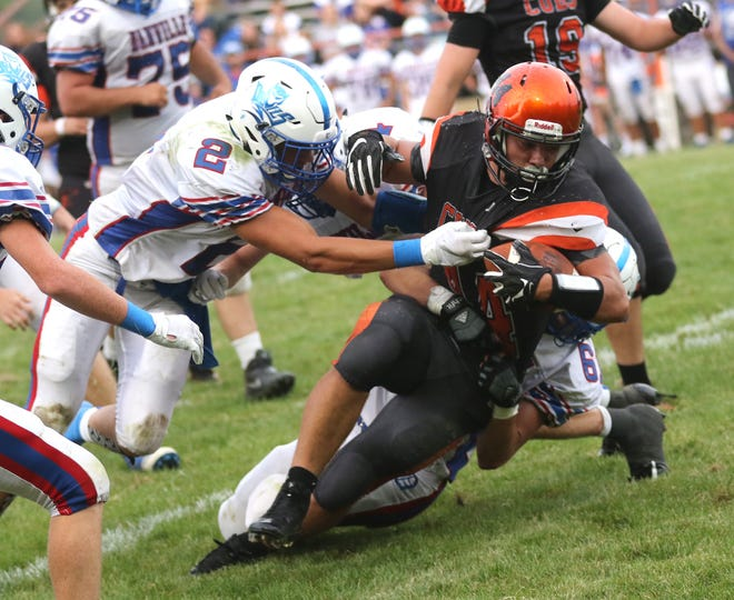 Lucas' Jeb Grover is tackled while playing a home game against Danville in Week 1.