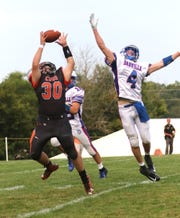 Lucas' Ethan Puckett attempts to catch a pass while playing a home game against Danville  on Friday.