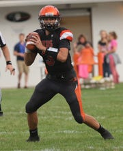 Lucas' Logan Niswander looks to throw a pass while playing a home game against Danville  on Friday.