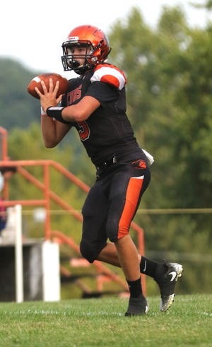 Lucas' Logan Niswander throws a pass while playing a home game against Danville in Week 1.