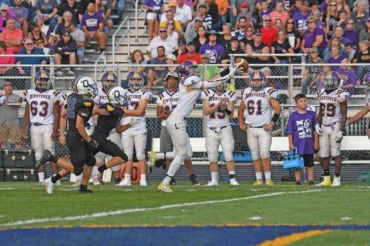Lexington's Josh Aiello hauls in a touchdown pass Friday night at Ontario High School.