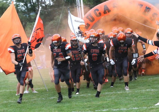 The Lucas football team takes to the field while playing a home game against Danville  on Friday.