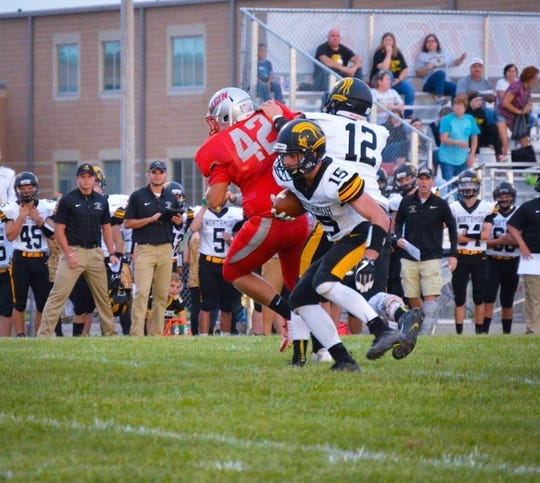 Northmor's Conor Becker makes a move in the backfield during a season-opening victory at Elgin Friday night.