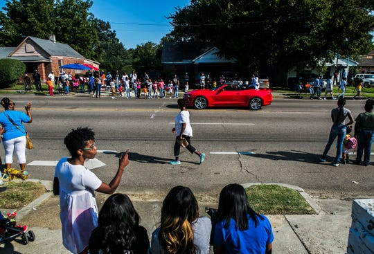 September 9, 2017 - Spectators watch the Southern Heritage Classic parade on Park Ave. in Orange Mound on Saturday. The event, hosted by the Orange Mound Parade Committee, featured high school and college marching bands, school and civic organizations, local politicians and businesses. (Yalonda M. James/The Commercial Appeal)