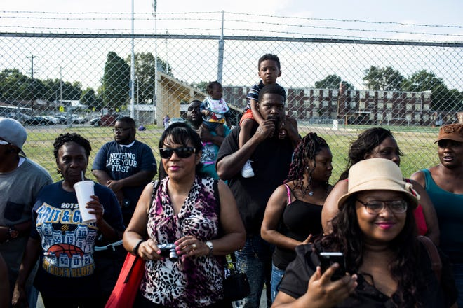 September 10, 2016 - A group of people wait for the start of the Classic Parade along Park Ave presented by the Orange Mound Parade Committee. Thousands lined Park Ave to see the parade that featured area high school marching bands among numerous other marchers.(Brad Vest/The Commercial Appeal)