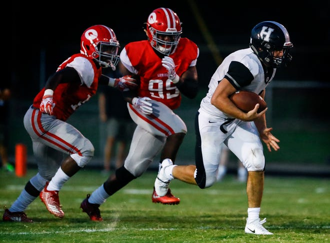 Houston running back Lincoln Pare runs away from the Germantown defense for a touchdown during action of their prep football game in Germantown.