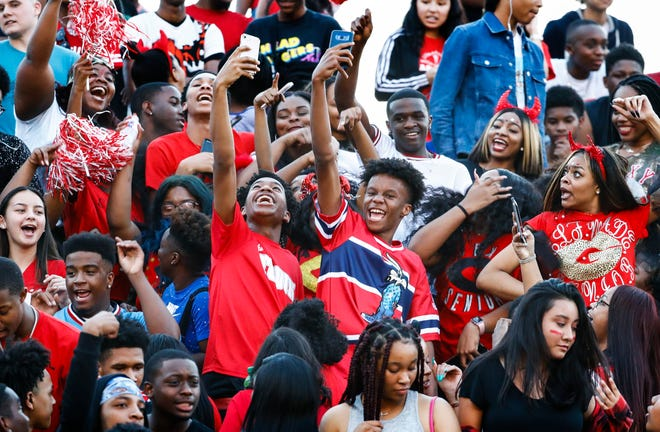 Germantown fans celebrate during action Houston in their prep football game in Germantown.