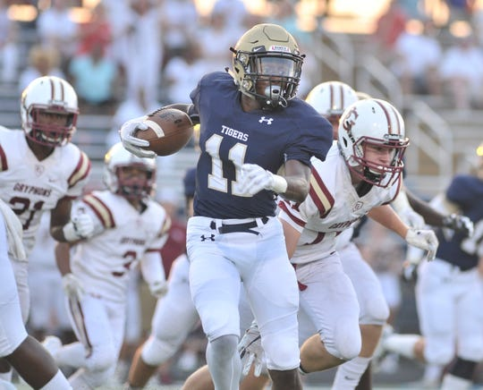 Arlington's Devin Chandler carries the ball against St. George's on Aug. 24, 2018.