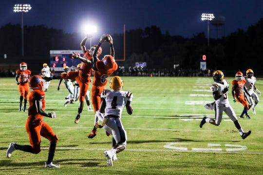August 24 2018 - Southaven's Caleb Offord goes up for an interception during Friday night's game between Southaven and Olive Branch.