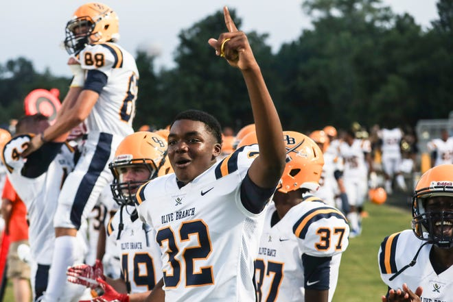 August 24 2018 - Olive Branch's Jared Howard celebrates after an Olive Branch touchdown during Friday night's game between Southaven and Olive Branch.