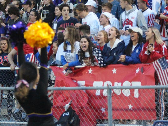 New Berlin Eisenhower fans sing the school song after a touchdown against Pewaukee on August 24.