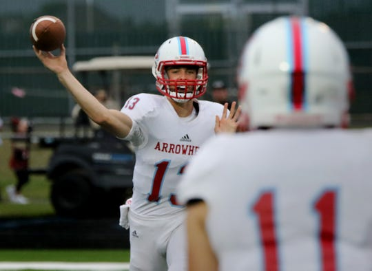 Arrowhead quarterback Tommy Darrow targets Jacob Schleicher with a pass on Aug. 24.
