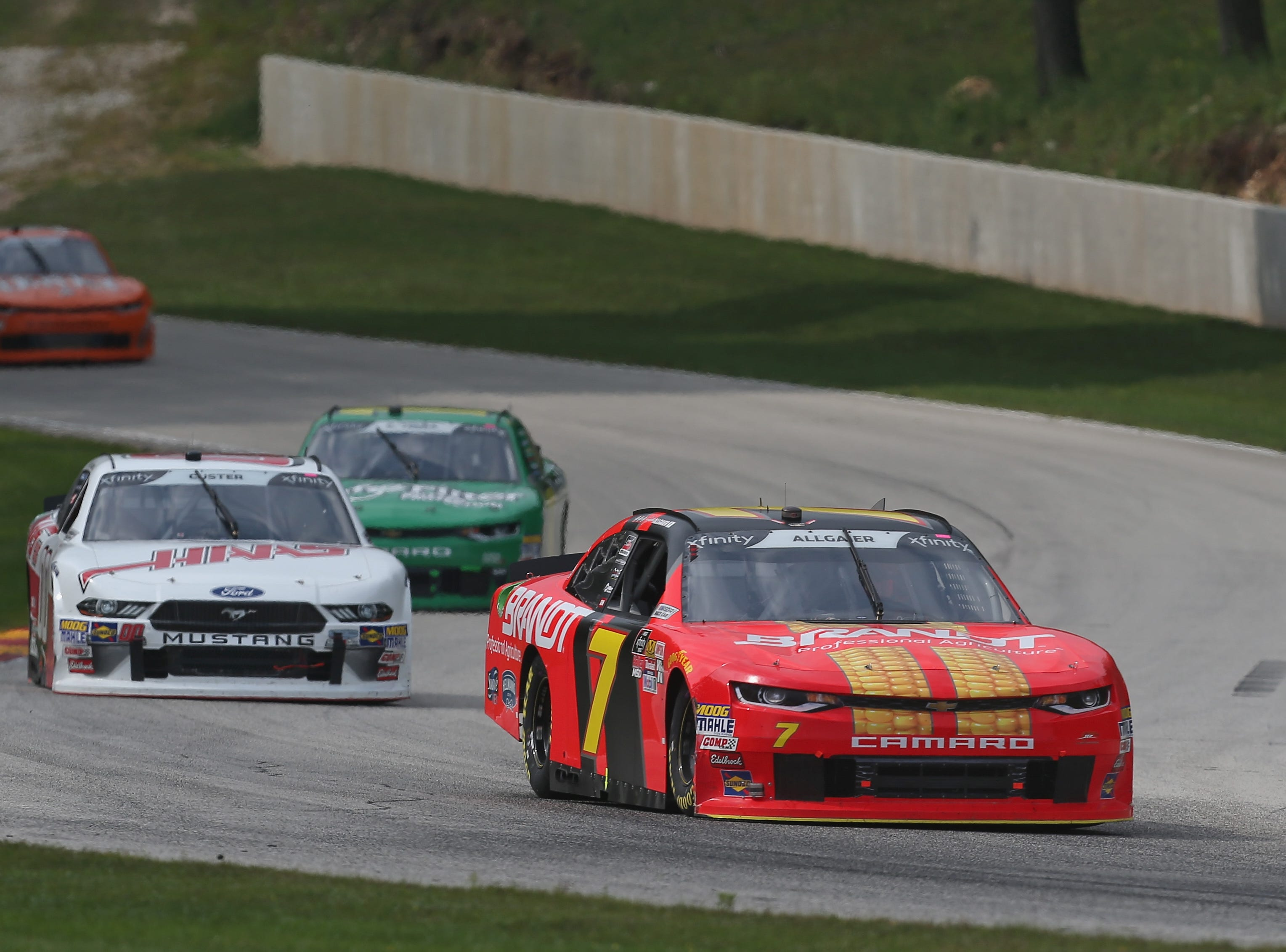 ELKHART LAKE, WI - AUGUST 25:  Justin Allgaier, driver of the #7 BRANDT Professional Agriculture Chevrolet, leads a pack of cars during the NASCAR Xfinity Series Johnsonville 180 at Road America on August 24, 2018 in Elkhart Lake, Wisconsin.  (Photo by Matt Sullivan/Getty Images)