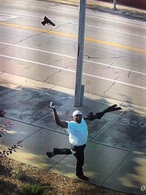 A suspect tosses a firearm while fleeing police after an attempted armed robbery was reported Wednesday.
