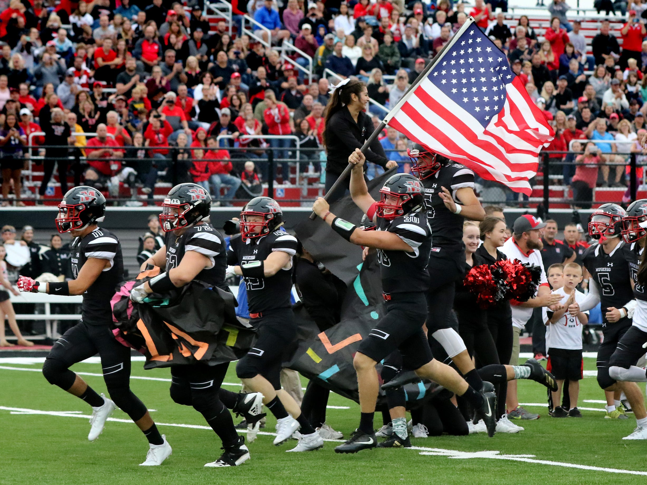 Muskego charges on to the field before its game at home against Arrowhead on Aug 24.