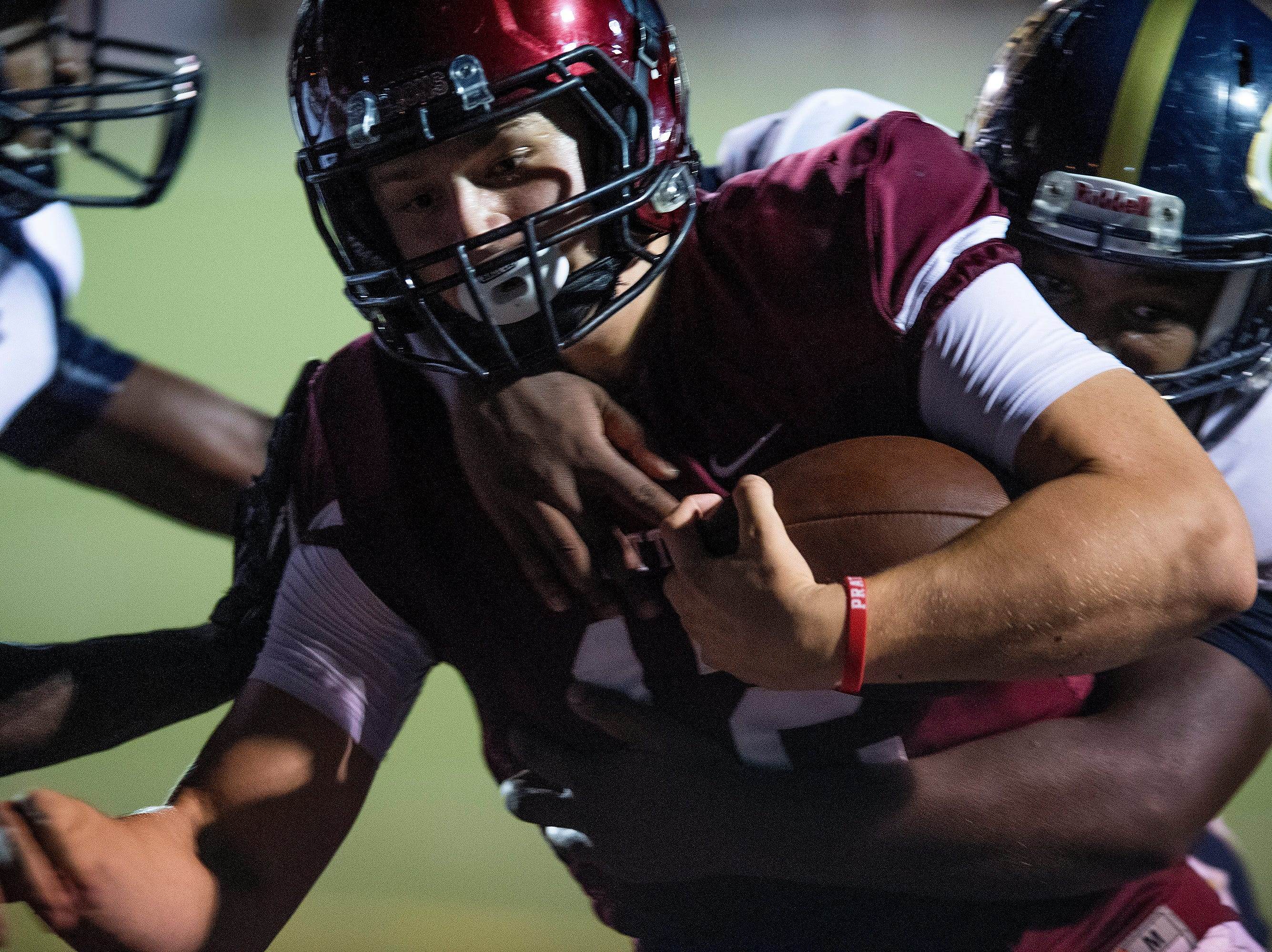 Prattville's Kyle Kramer (12) carries thew ball in for a touchdown against Foley at Stanley-Jensen Stadium in Prattville, Ala., on Friday August 24, 2018.