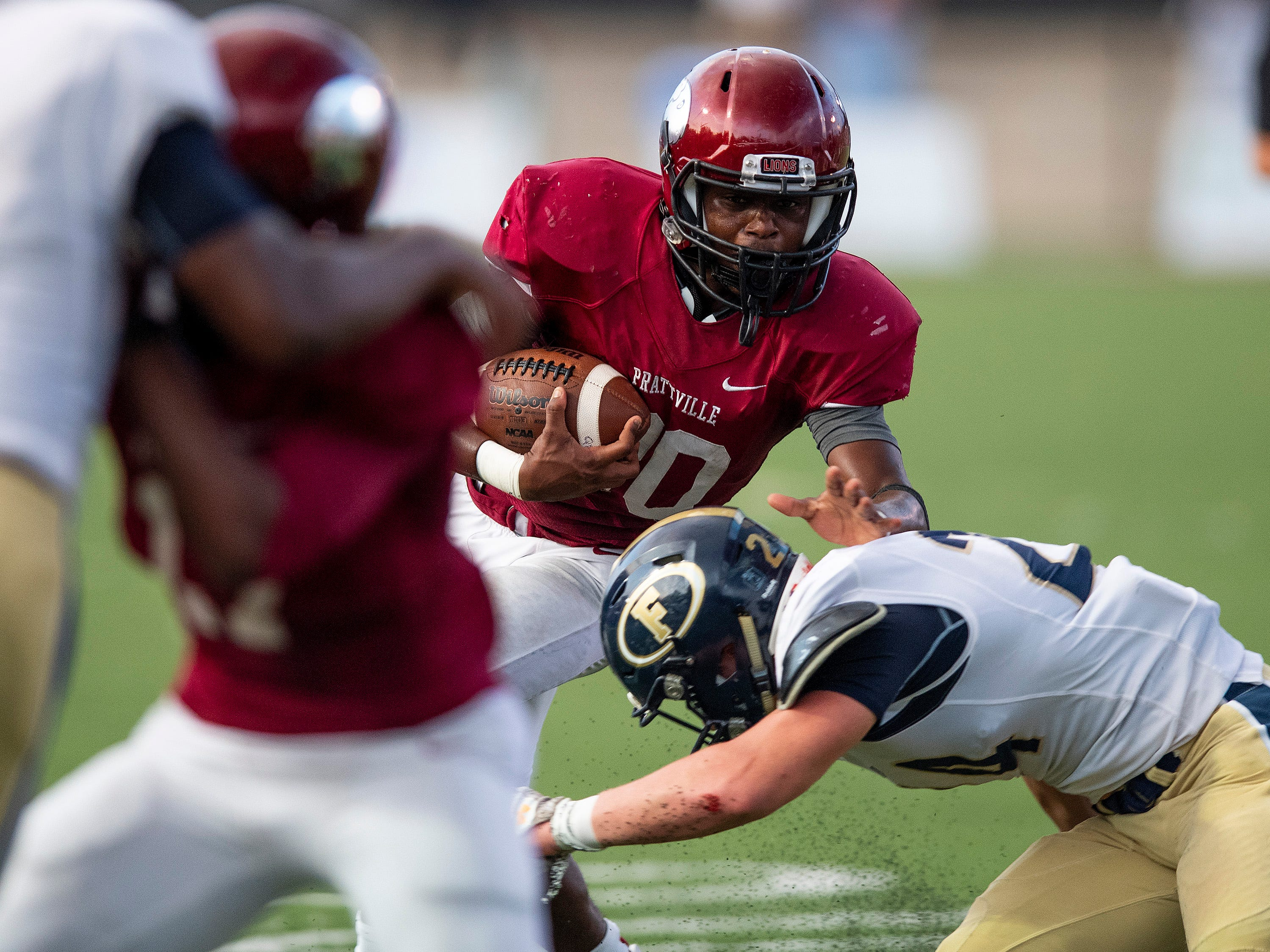Prattville's Keondre Powell (20) fights for yardage against Foley at Stanley-Jensen Stadium in Prattville, Ala., on Friday August 24, 2018.