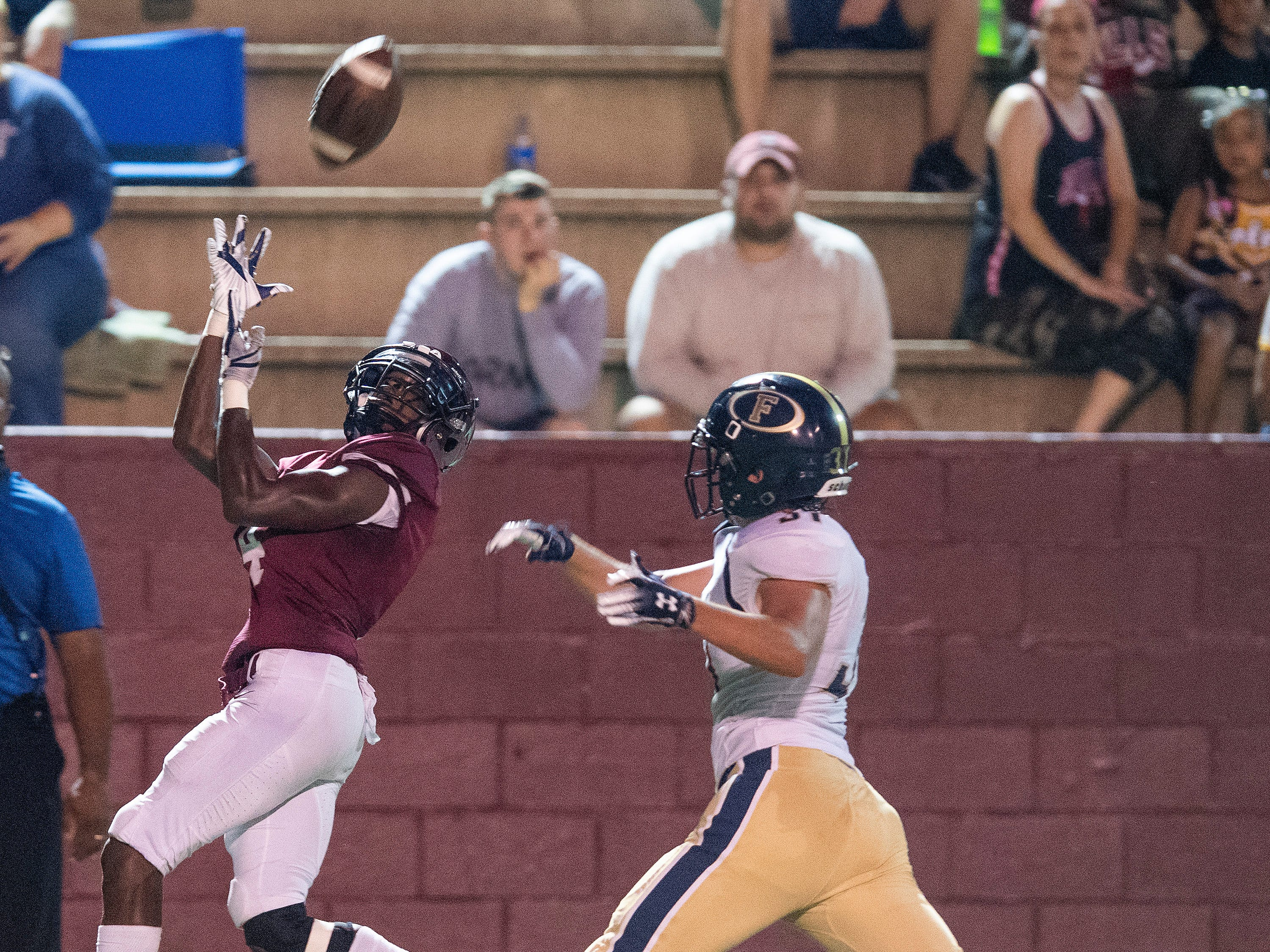 Prattville's Malik Smith misses a catch against Foley at Stanley-Jensen Stadium in Prattville, Ala., on Friday August 24, 2018.