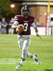 Montgomery Academy's Daniel Lindsey scrambles after his receiver becomes unavailable.