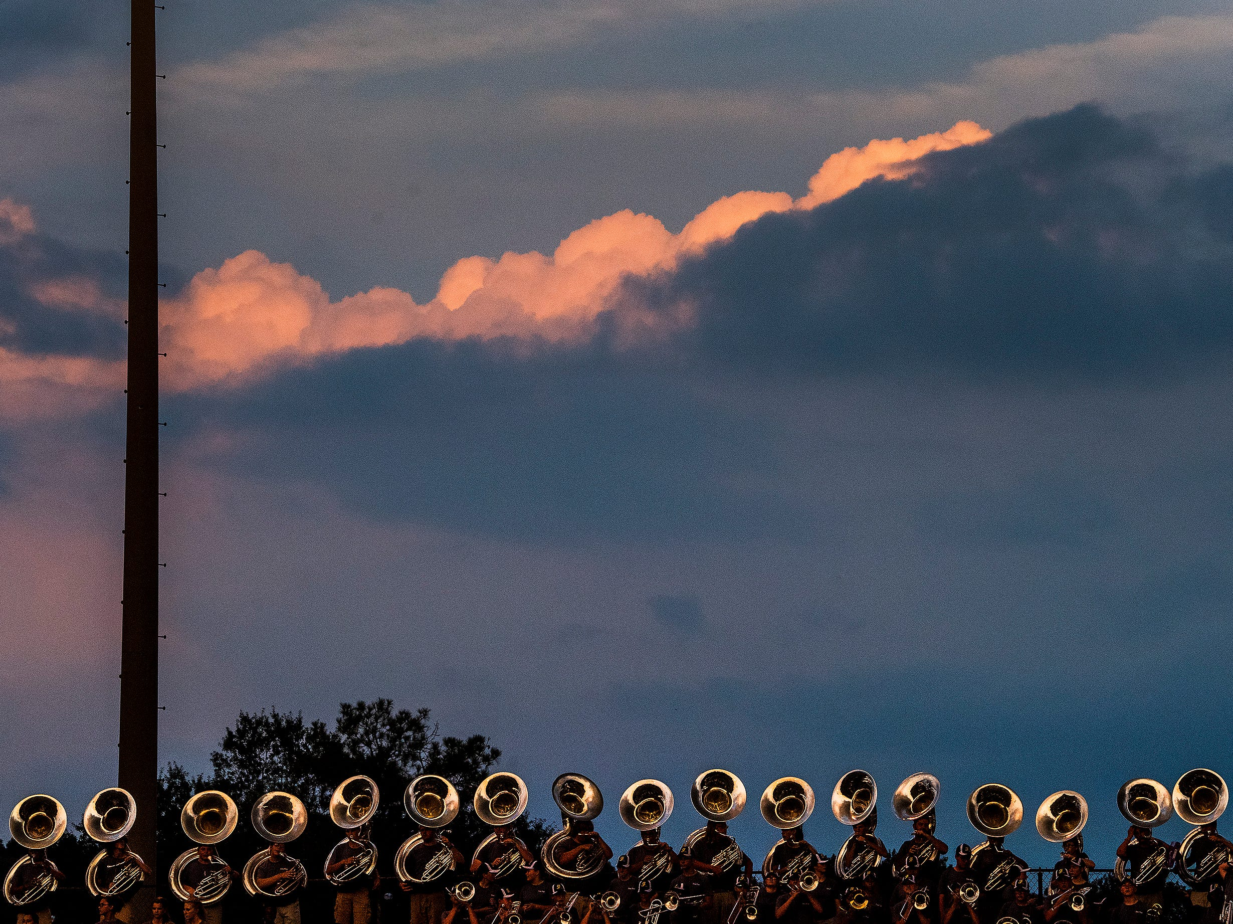 The sun sets over thew Foley band during the Prattville Foley game at Stanley-Jensen Stadium in Prattville, Ala., on Friday August 24, 2018.
