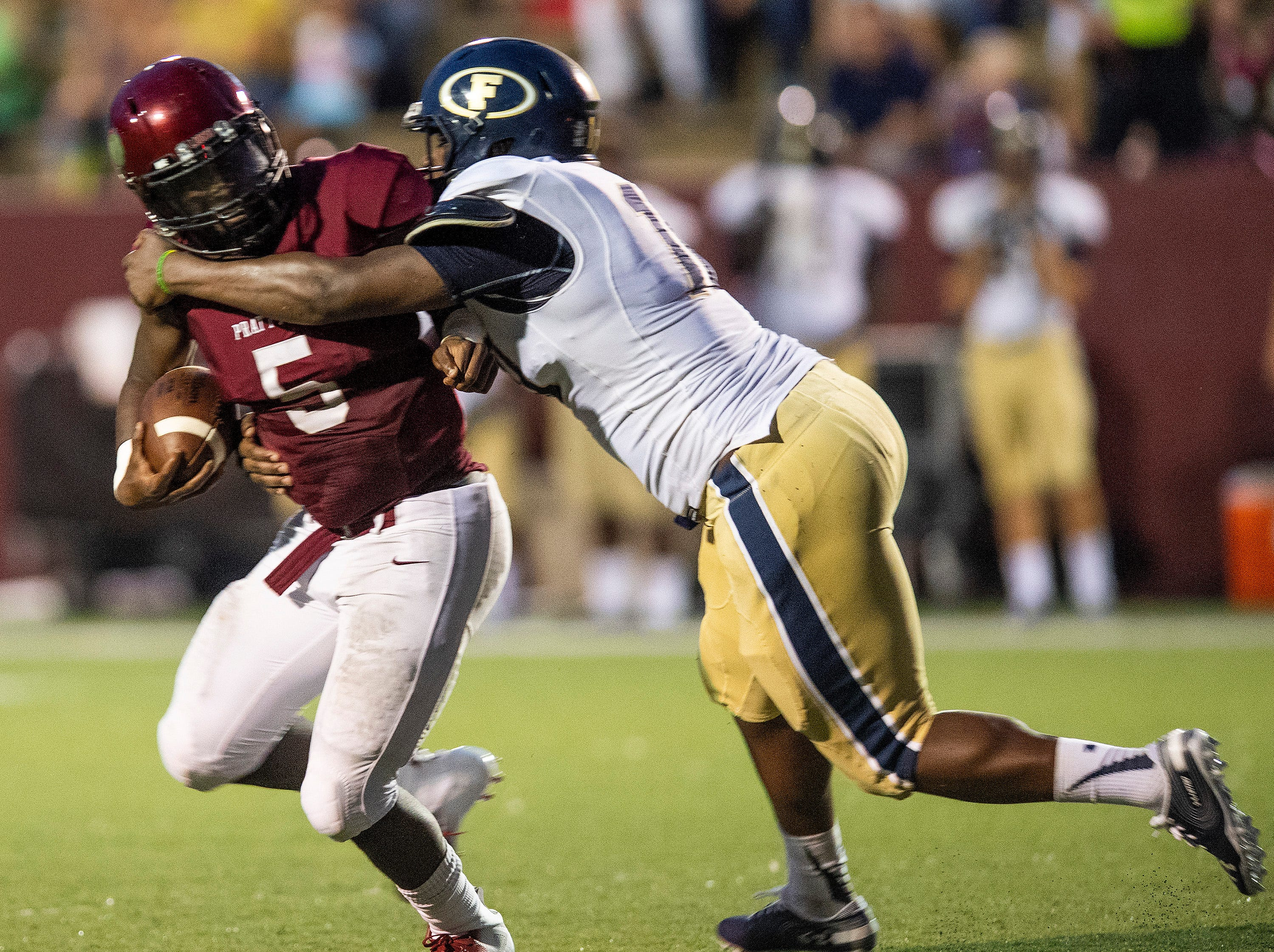 Prattville's Traair Edwards is stopped by Foley's Demarion Johnson at Stanley-Jensen Stadium in Prattville, Ala., on Friday August 24, 2018.
